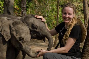 Professor Virpi Lummaa and the baby elephant twins in Myanmar